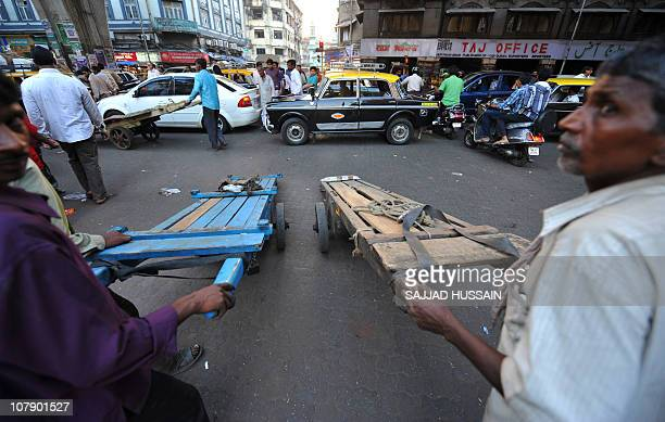 LifestyleIndiasocietyhealthangerFEATURE by Phil HazlewoodThis photo taken on December 23 2010 shows Indian workers waiting to cross a road during a...