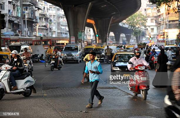 LifestyleIndiasocietyhealthangerFEATURE by Phil HazlewoodThis photo taken on December 23 2010 shows a pedestrian crossing a busy road amongst the...