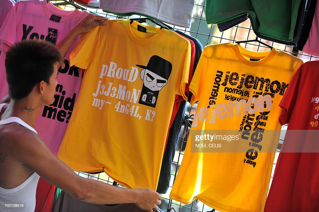 STORY 'Lifestyle-Internet-Philippines-telecoms-language, FEATURE by Jason Gutierrez A vendors shows T-shirts with prints of cyber dialect called 'jejemon' at Divisoria market in Manila on June 13, 2010. The Philippines is being overwhelmed by what authorities say is a language monster that has invaded youth speak in Internet social networks and mobile phone text messaging. The phenomenon has triggered enormous debate with the government declaring an 'all out war' against the cyber dialect, called 'jejemon', but with the Catholic church defending it as a form of free expression. The word 'jejemon' is derived from 'jeje' as a substitute for 'hehe' -- the SMS term for laughter -- and then affixing it with 'mon' -- taken from the popular Japanese anime of cute trainable monsters called 'Pokemon.'