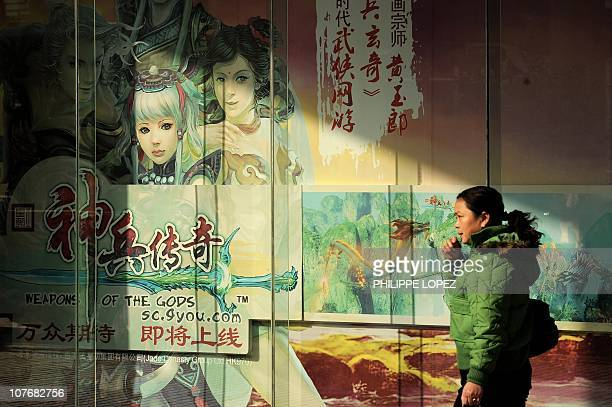 LifestyleITChinaUSgameFacebook by Joan FengPicture taken on December 7 2010 shows a woman walking past a billboard showing characters of an...