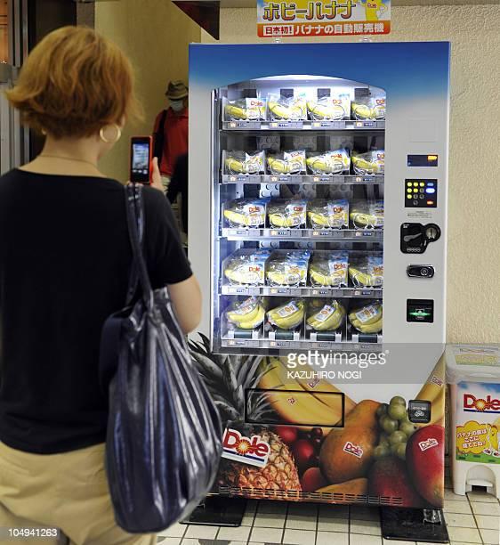 LifestyleJapanretailvendingmachinesFEATURE by Miwa Suzuki This photo taken on August 25 2010 shows a woman taking a photo of a vending machine that...