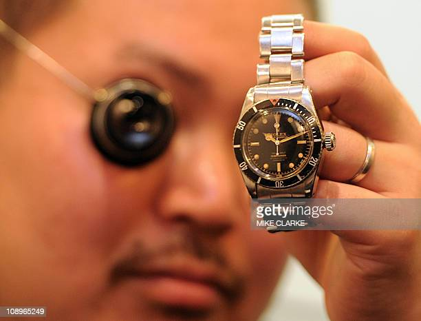 LifestyleluxuryHongKongwatchesFEATURE by Adrian AddisonThis photo taken on January 21 2011 shows watch expert Genki Sakamoto showing a 1958 Rolex...