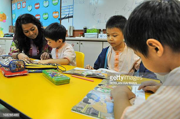 STORY 'LifestyleSingaporeeducationsocietyFEATURE' by Idayu Suparto This photo taken on May 25 2010 shows children attending their preschool class in...