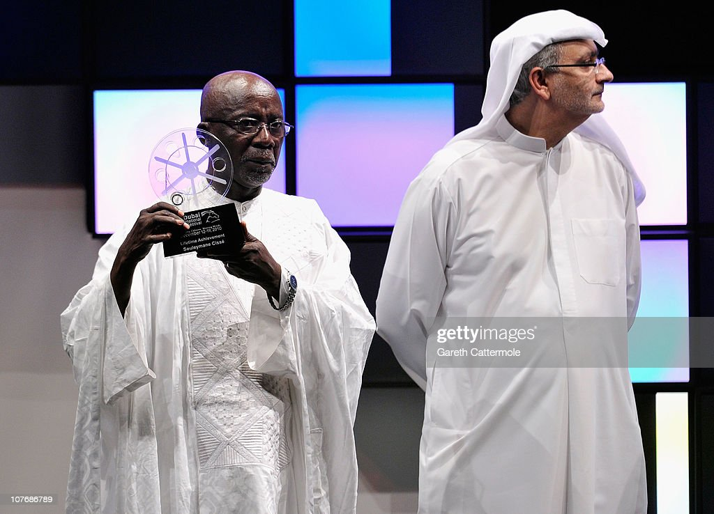 Lifetime Achievement honouree director Souleymane Cisse and Artistic Director of DIFF Masoud Amralla Al Ali on stage during the Closing Night Muhr Awards Ceremony on day eight of the 7th Annual Dubai International Film Festival held at the Madinat Jumeriah Complex on December 19, 2010 in Dubai, United Arab Emirates.