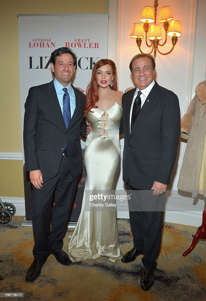 Lifetime EVP Programming Rob Sharenow, actress <a gi-track='captionPersonalityLinkClicked' href=/galleries/search?phrase=Lindsay+Lohan&family=editorial&specificpeople=171623 ng-click='$event.stopPropagation()'>Lindsay Lohan</a> and executive producer Larry Thompson attend a private dinner for the Lifetime premier of 'Liz & Dick' at Beverly Hills Hotel on November 20, 2012 in Beverly Hills, California.