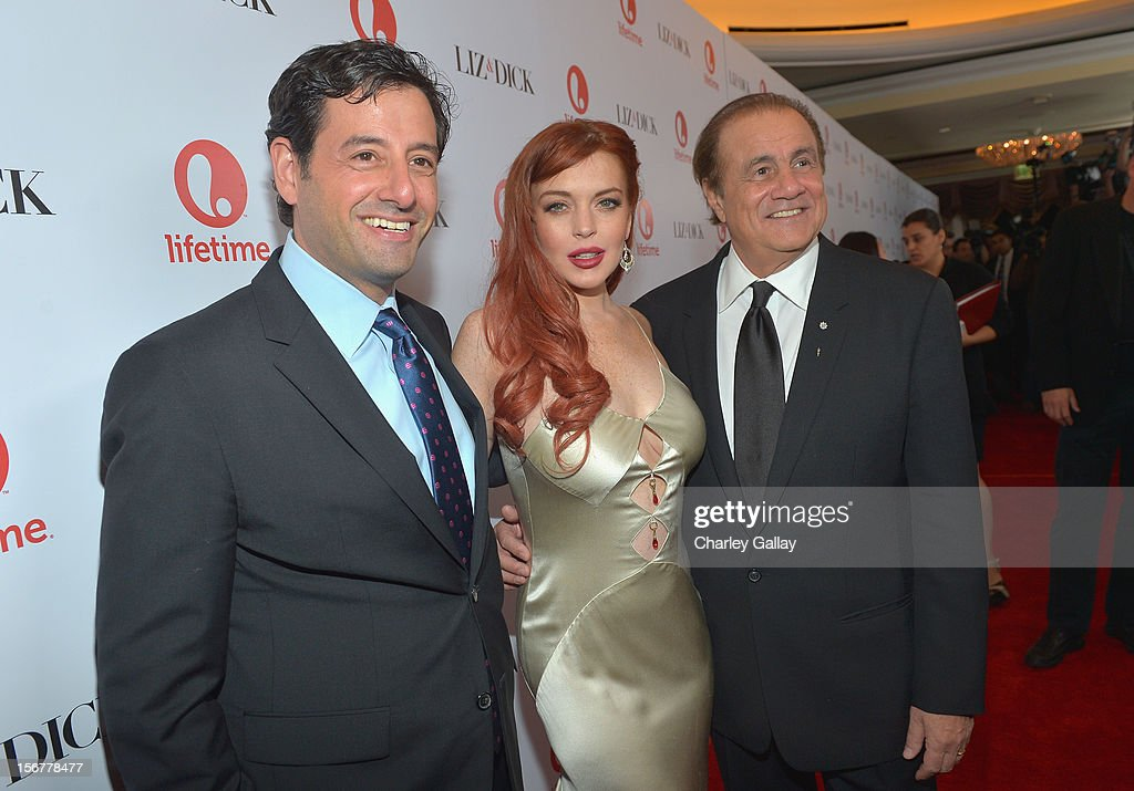 Lifetime EVP Programming Rob Sharenow, actress Lindsay Lohan and executive producer Larry Thompson attend a private dinner for the Lifetime premier of 'Liz & Dick' at Beverly Hills Hotel on November 20, 2012 in Beverly Hills, California.