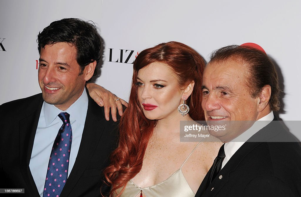 Lifetime EVP Programming Rob Sharenow, actress Lindsay Lohan and Executive Producer Larry Thompson arrive at the 'Liz & Dick' - Los Angeles Premiere at Beverly Hills Hotel on November 20, 2012 in Beverly Hills, California.