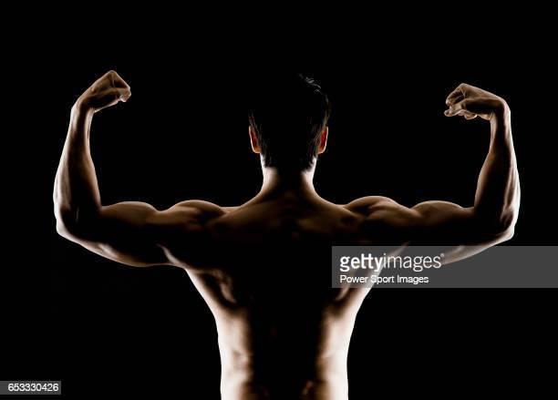 Lifetime natural Hong Kong Powerlifting IFBB Men's Physique Champion Sebastian Mok poses during a photo shooting in Hong Kong on November 182015