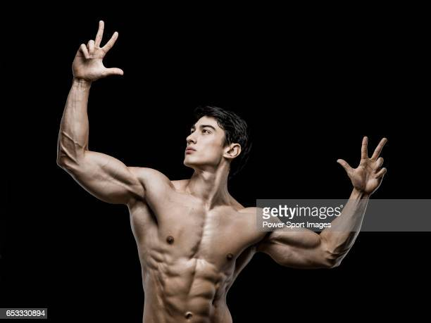 Lifetime natural Hong Kong Powerlifting IFBB Men's Physique Champion Sebastian Mok poses during a photo shooting in Hong Kong on November 182015