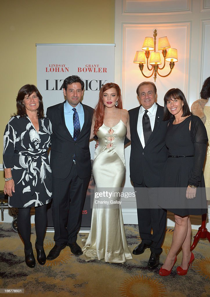 Lifetime SVP Original Movies Tanya Lopez, Lifetime EVP Programming Rob Sharenow, actress <a gi-track='captionPersonalityLinkClicked' href=/galleries/search?phrase=Lindsay+Lohan&family=editorial&specificpeople=171623 ng-click='$event.stopPropagation()'>Lindsay Lohan</a>, executive producer Larry Thompson, and Lifetime VP Original Movies Nancy Bennett attend a private dinner for the Lifetime premier of 'Liz & Dick' at Beverly Hills Hotel on November 20, 2012 in Beverly Hills, California.