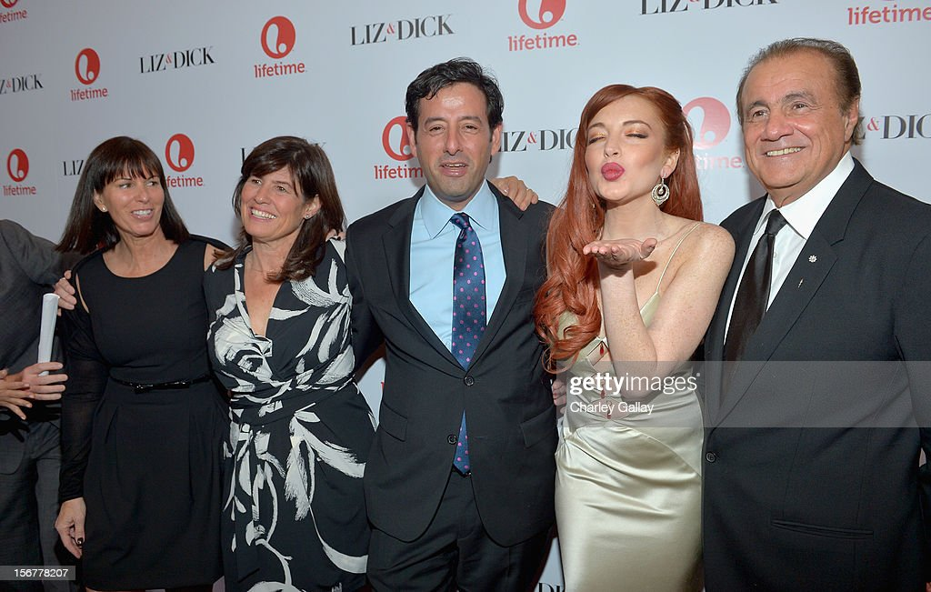 Lifetime VP Original Movies Nancy Bennett, Lifetime SVP Original Movies Tanya Lopez, Lifetime EVP Programming Rob Sharenow, actress Lindsay Lohan, and executive producer Larry Thompson attend a private dinner for the Lifetime premier of 'Liz & Dick' at Beverly Hills Hotel on November 20, 2012 in Beverly Hills, California.
