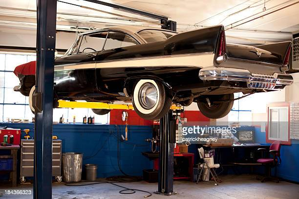 Lifted classic car in auto repair shop