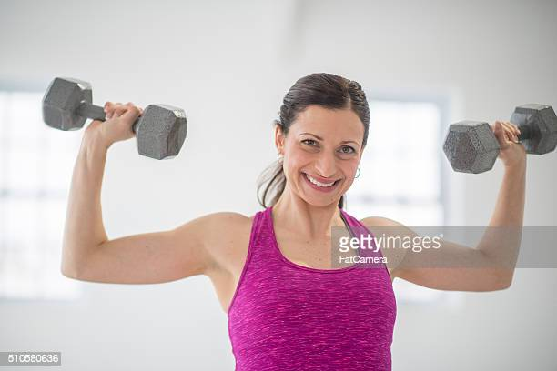 Lifting Dumbbells at the Gym.