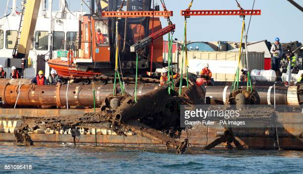 Lifting equipment raises the remains of a crashed World War II Dornier bomber the only surviving German Second World War Dornier Do 17 bomber from...