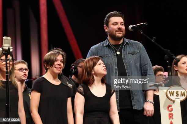 Lifting Lives music Campers join Singersongwriter Chris Young on stage during a Performance at Grand Ole Opry House on June 27 2017 in Nashville...