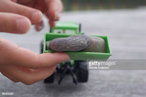 Lifting stones with a toy front loader