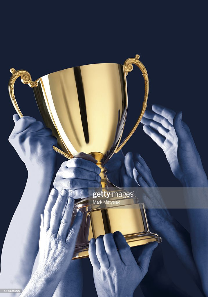 Lifting the golden cup : Stock Photo