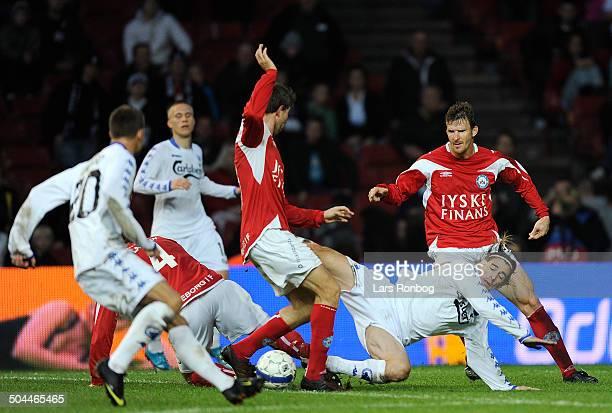 Liga César Santin FCK knocked down by Jim Larsen Silkeborg IF behind him Steven Lustü Silkeborg IF © Lars Rønbøg / Frontzonesport
