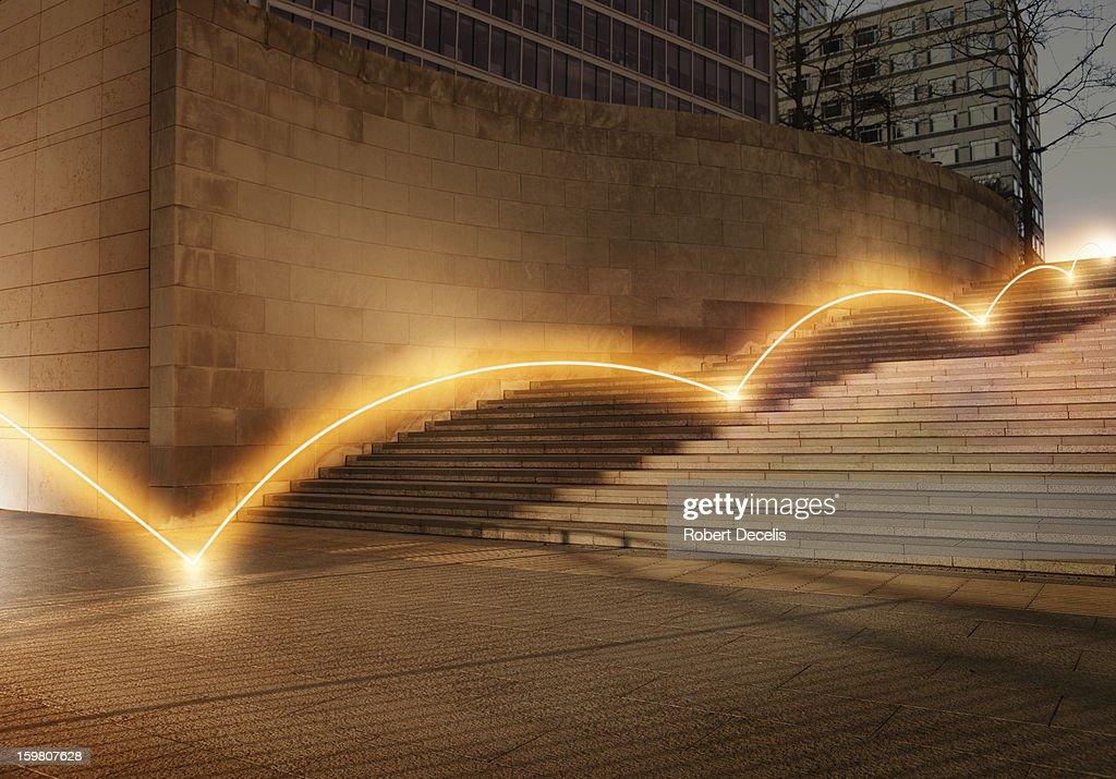 Ligh trail bouncing down steps. : ストックフォト