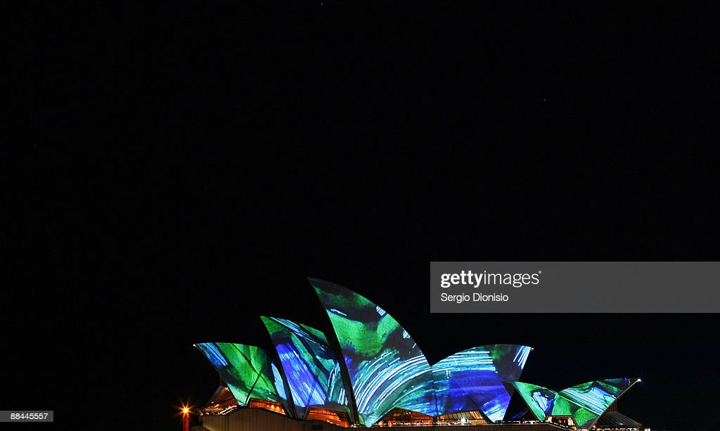 A light art work by artist and musician Brian Eno is projected onto the Sydney Opera House during a recreation of 'Fire Water' the Sinking Of The 'Three Bees' on Sydney Harbour as part of the Vivid Sydney Festival on June 12, 2009 in Sydney, Australia.