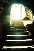 Light at the end of the tunnel. Dark room with a stone stairway encased in sunlight, Istanbul Eminonu big inn stairs