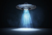 Light beam from flying UFO (alien spaceship). 3D rendered illustration.
