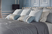 Light blue bedroom with pattern and texture of bedding