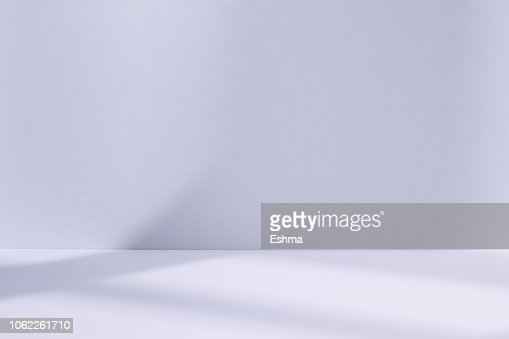 Light blue studio space with window shadow : Stock Photo