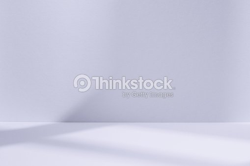 Light blue studio space with window shadow : Stock Photo