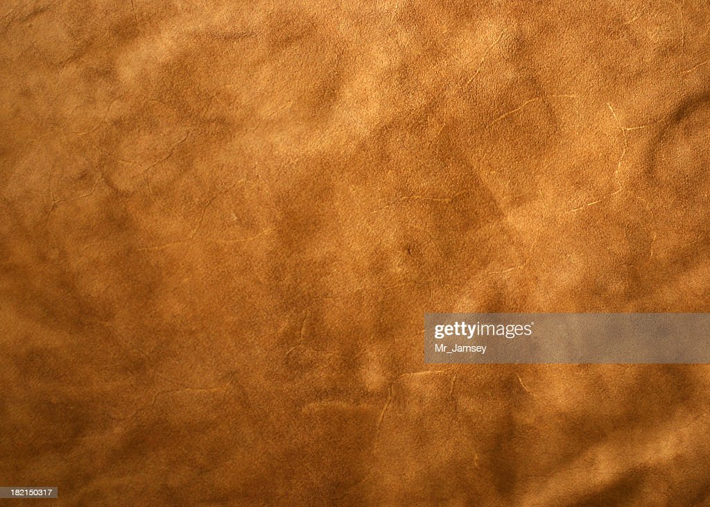 A light brown leather textured background