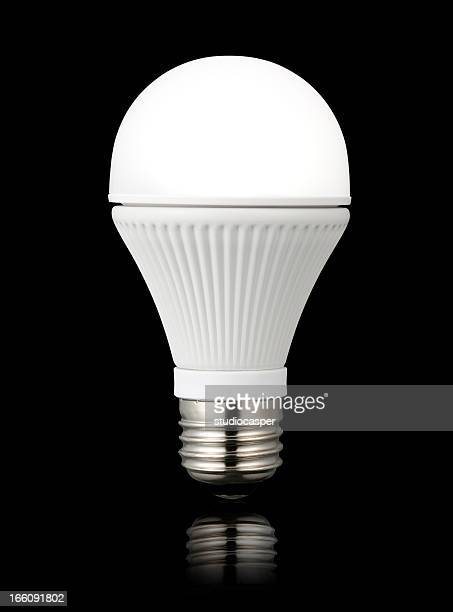 LED light bulb against a black background