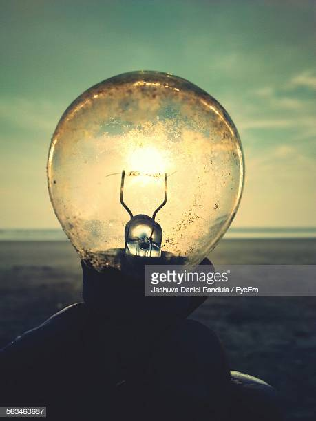 Light Bulb Against Sunset Sky