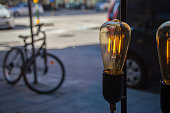 Light Bulb By Parked Bicycle On Street