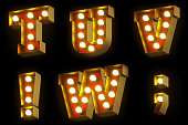 Light bulb cinema or night show 3D font on black background. Entertainment industry red and gold retro letters. Set 4 - T, U, V, W, exclamation sign, semicolon. 3D rendering.