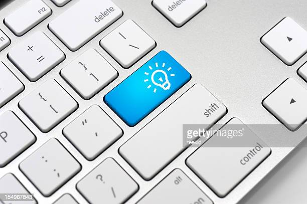 Light Bulb Icon On Computer Keyboard-Energy Saving Concepts and Ideas