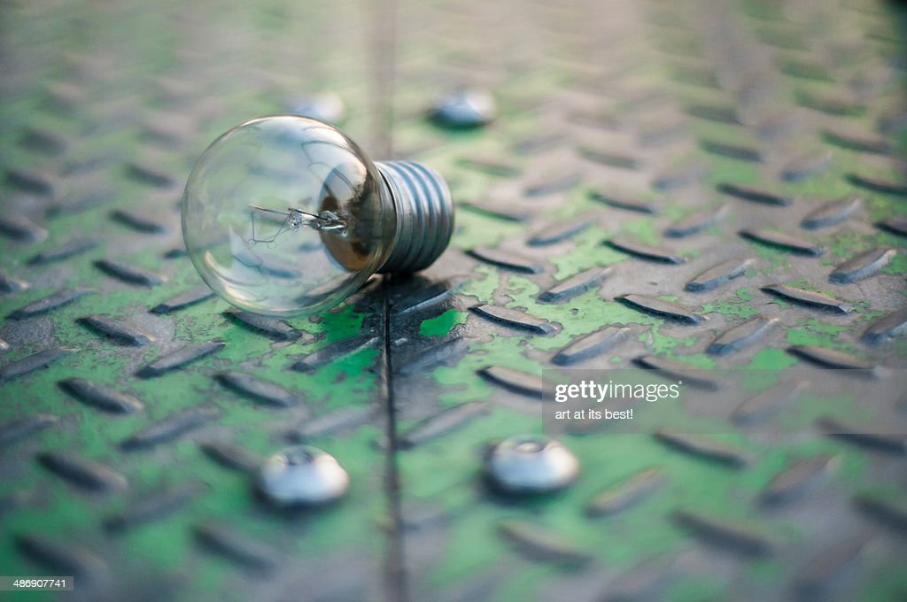 Light bulb on a checkered plate