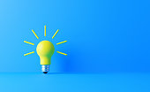 Light bulb on blue background. Horizontal composition with copy space. Creativity and innovation concept.