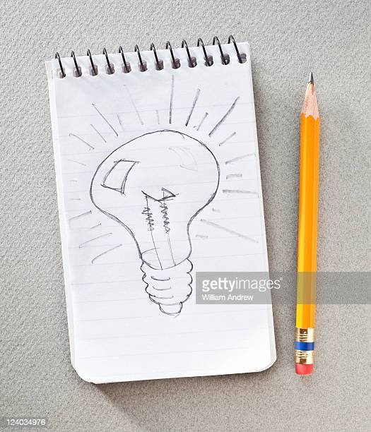 Light bulb sketched on notepad