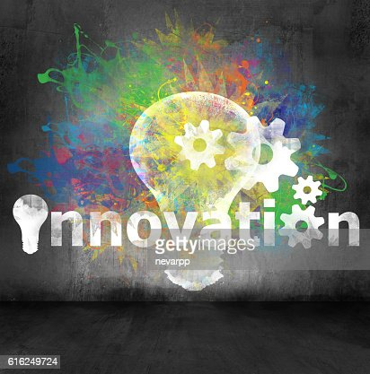 light bulb symbol with text innovation painted on cement wall : Stock Photo