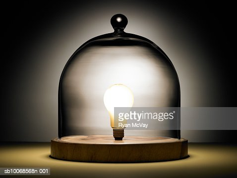 Light bulb under glass dome : Stock Photo