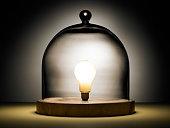 Light bulb under glass dome