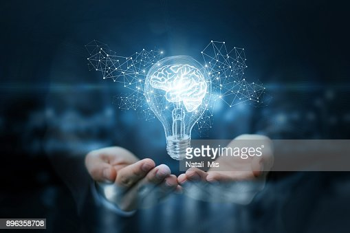 Light bulb with brain inside the hands of the businessman. : Foto de stock