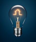 Light bulb with filament forming a house icon on blue background
