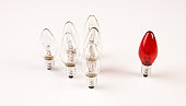 Light bulbs. Big idea concept, Bright Creative and Leadership concept with one red lamp many different glass light bulbs on white background.