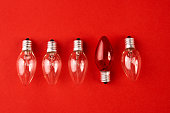 Light bulbs. Big idea concept, Bright Creative and Leadership concept with one red lamp many different glass light bulbs on red background.