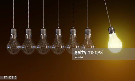 Light bulbs in perpetual motion : Stock Photo