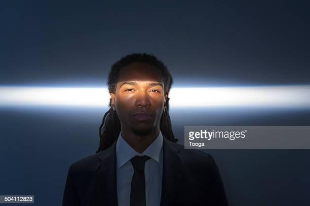 Light crossing man's face