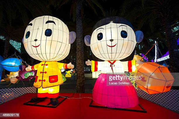 Light decorations are displayed as midAutumn celebrations take place at dusk on September 24 2015 in Victoria Park Hong Kong The MidAutumn Festival...