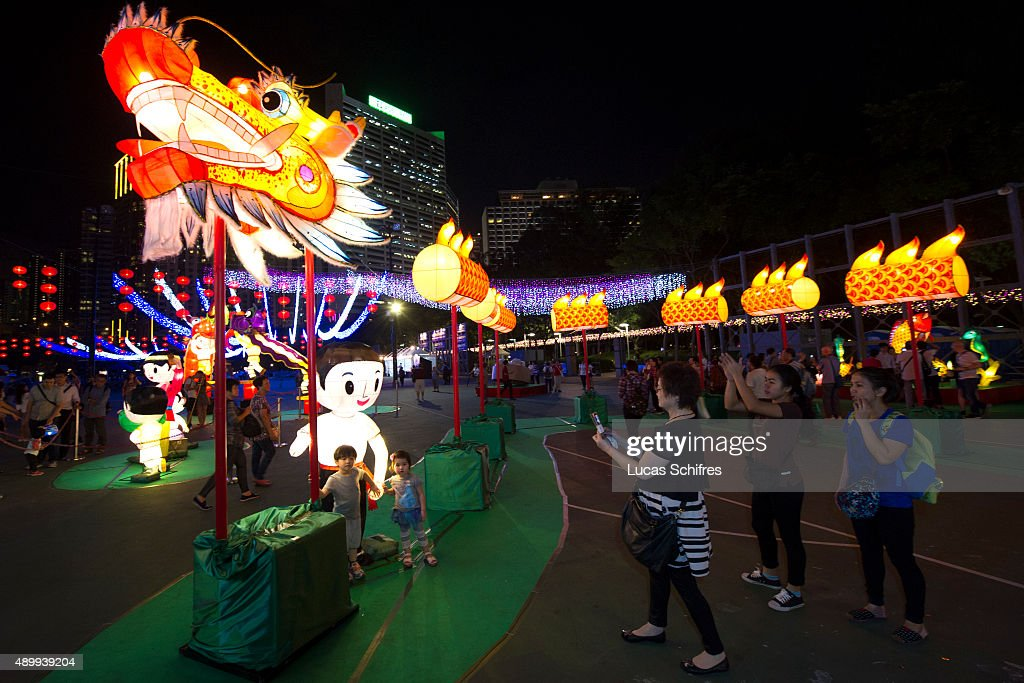 Light Decorations Are Displayed As Mid Autumn Celebrations Take Place At  Dusk On September 24