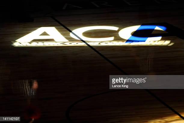 Light depicting the ACC logo shines on the court prior to a game between the North Carolina State Wolfpack and the North Carolina Tar Heels during...
